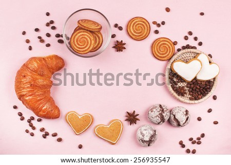 Sweet frame of cookies, croissant, coffee beans and cup of coffee - stock photo