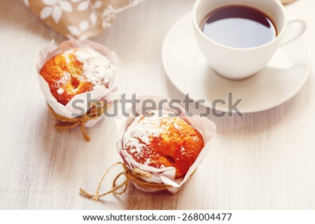 Sweet Fresh Baked Muffins with Cup of Coffee for Morning Breakfast. Image toned, selective focus. - stock photo