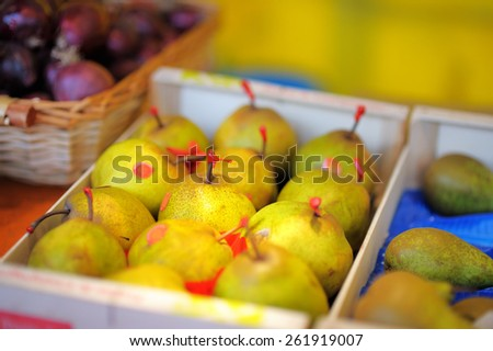 Sweet fresh bio pears on Paris farmer agricultural market - stock photo