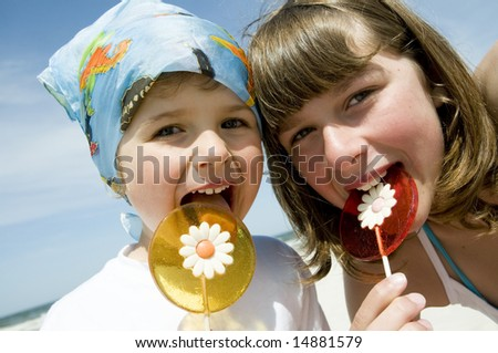 Sweet girls with lollipop - stock photo