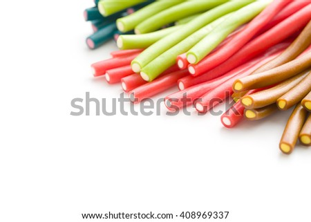Sweet gummy sticks with different flavor. Tasty candies isolated on white background. - stock photo