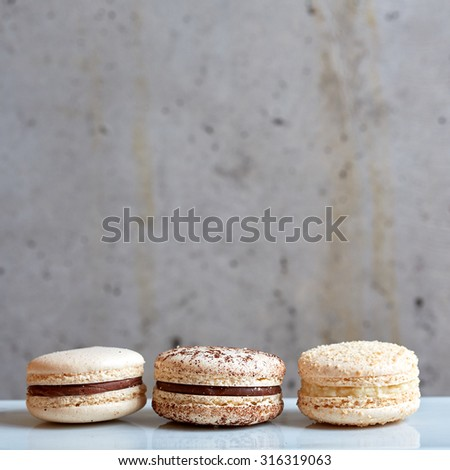Sweet handmade macaroon on grey background. Shallow dof - stock photo