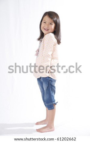 sweet happy  little asian girl on a white background - stock photo