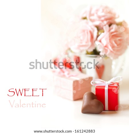 Sweet heart chocolate and roses on a white background. - stock photo