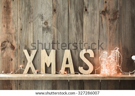 Sweet home. White Christmas decor and fairy lights on vintage natural wooden background. - stock photo