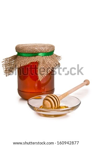 Sweet honey in jar with drizzler isolated on white - stock photo