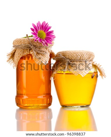 Sweet honey in jars isolated on white - stock photo