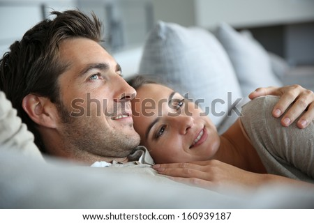 Sweet in love couple dreaming of their future - stock photo