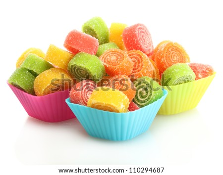 sweet jelly candies in cup cake cases isolated on white - stock photo
