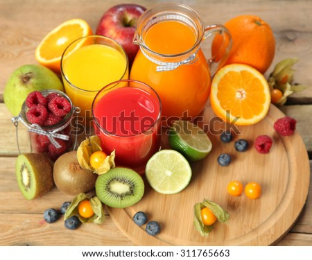 sweet juice and fruits on wood - stock photo
