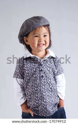 sweet little asian girl with a hat - stock photo