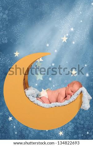 Sweet little baby boy Sleeping in moon in the stars - stock photo