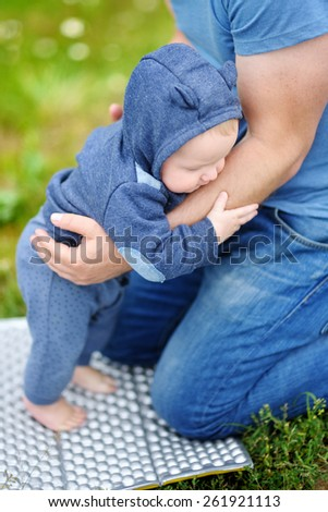 Sweet little baby learning to stand or to walk - stock photo