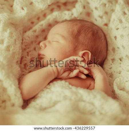 sweet  little baby sleeping on a white cloth - stock photo