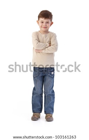 Sweet little boy smiling arms crossed, looking at camera. - stock photo