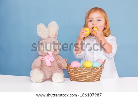 sweet little easter girl with eggs - stock photo