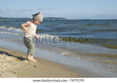 sweet little girl on the beach. summertime - stock photo
