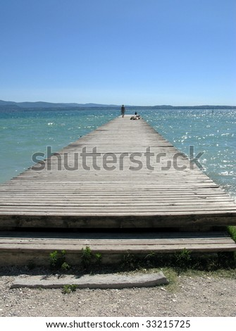 Sweet Loneliness.Lake Guarda. The world-famous resort Sirmione. Italy. - stock photo