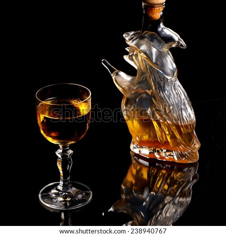 Sweet mead in glass on black background - stock photo