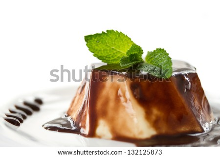 sweet milk dessert with chocolate sauce and mint - stock photo