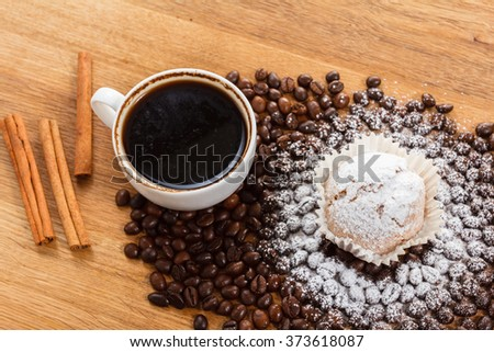Sweet muffin and coffee on wooden background, tasty breakfast. Overhead view closeup. - stock photo