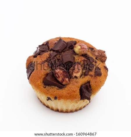 Sweet muffin with chocolate and hazelnut, isolated on white  - stock photo