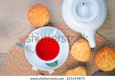 sweet muffins on wooden table - stock photo