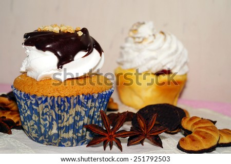 Sweet muffins with whipped cream and chocolate sauce, - stock photo