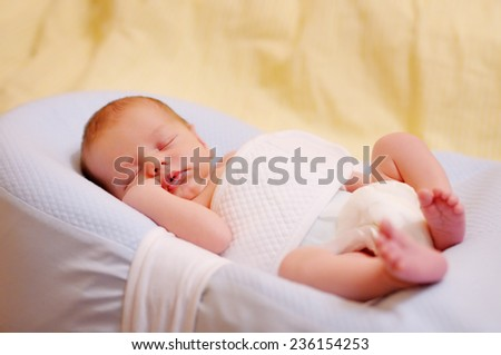 Sweet newborn baby sleeping, closeup portrait - stock photo