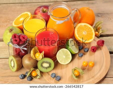 sweet orange juice on wooden table - stock photo