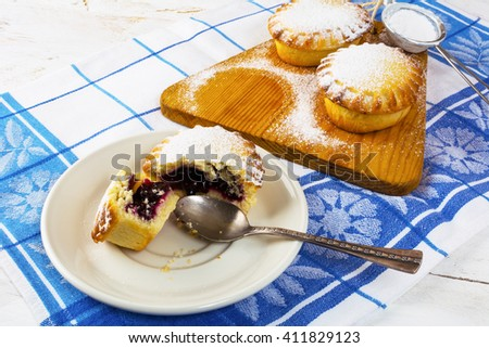 Sweet pie on the cutting board. Jam pie. Small pie. Pie. Sweet dessert . Sweet pastry.  - stock photo