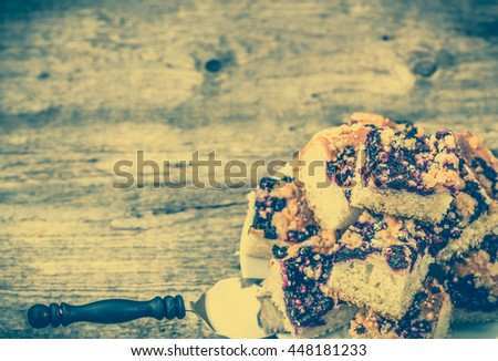 Sweet pie with blueberry fruits on yeast pastry, summer baking concept, vintage photo, copy space - stock photo