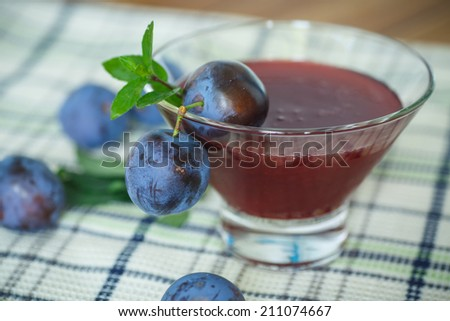sweet plum jam on the table with plums - stock photo