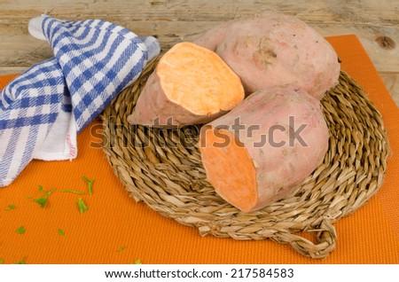 Sweet potato halved showing its orange inside - stock photo