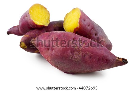 Sweet potatoes. Cooked whole and halved sweet potatoes. - stock photo