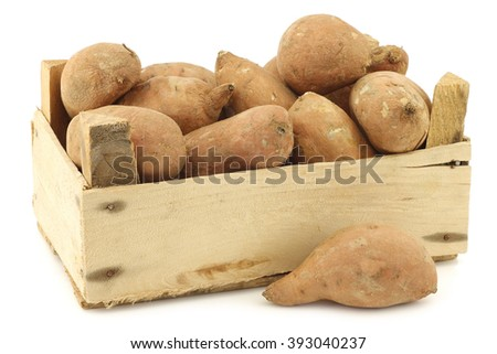 sweet potatoes in a wooden crate on a white background - stock photo