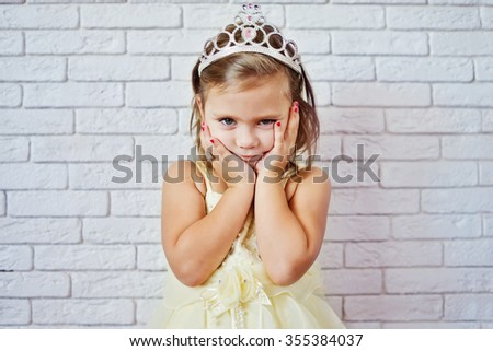 sweet princess girl with crown and red nail - stock photo