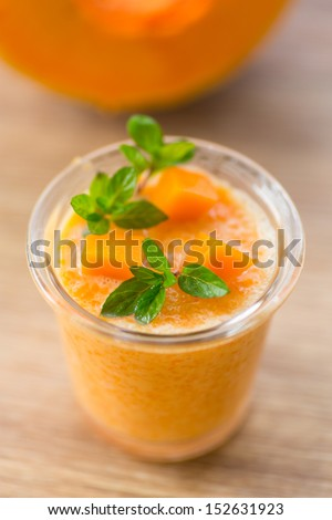 sweet pumpkin smoothies with chunks of pumpkin and mint - stock photo