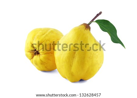 sweet quinces with leaves and slice on white  with a clipping path - stock photo