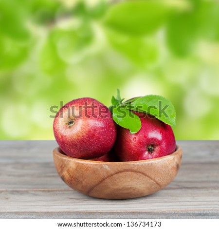 Sweet red apple in the bowl - stock photo
