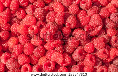 Sweet red raspberries as a background - stock photo