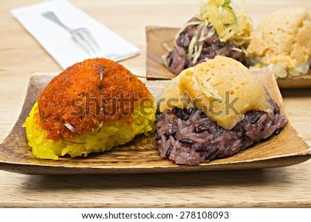 sweet rice custard on wooden dish with tea cup set. - stock photo
