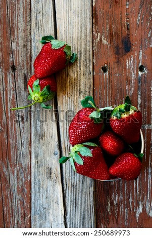 Sweet ripe strawberries over rustic wooden texture. Top view. - stock photo