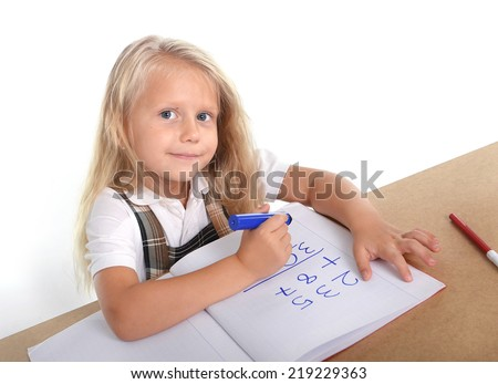 sweet sad and overwhelmed little blonde hair school girl looking bored and tired in stress with books and homework in children education concept isolated on white background - stock photo