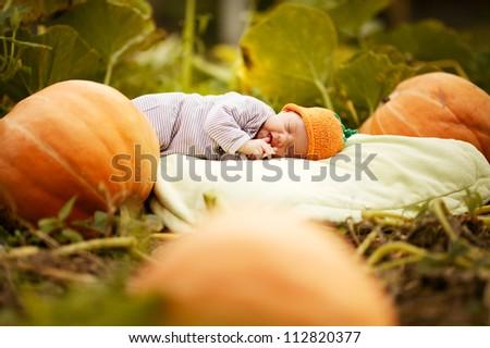 sweet sleeping baby with pumpkin hat - stock photo