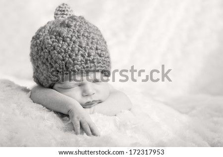 sweet sleeping baby with pumpkin hat (black and white) - stock photo
