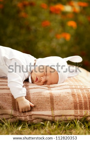 sweet sleeping baby with rabbit costume - stock photo