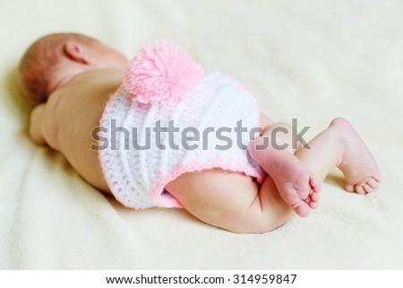 sweet sleeping newborn is wearing a bunny costume - stock photo