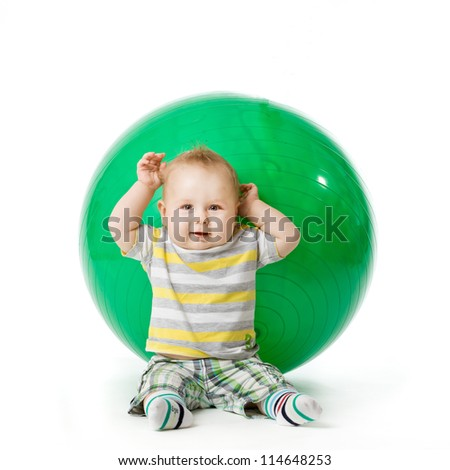 sweet small baby with fitness ball on a white background. - stock photo