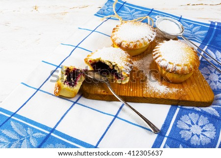 Sweet small pie, close up. Small pie. Pie. Jam pie. Sweet dessert. Sweet pastry. - stock photo